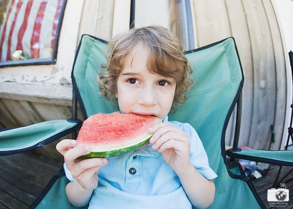 curly-haired-boy-eating-watermelon