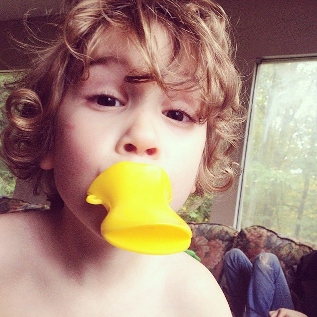 curly-haired-toddler-duck-ips