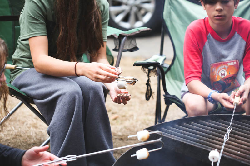 Camping in the rain can still be fun! You just need the right attitude and some fun sized Snickers bars.