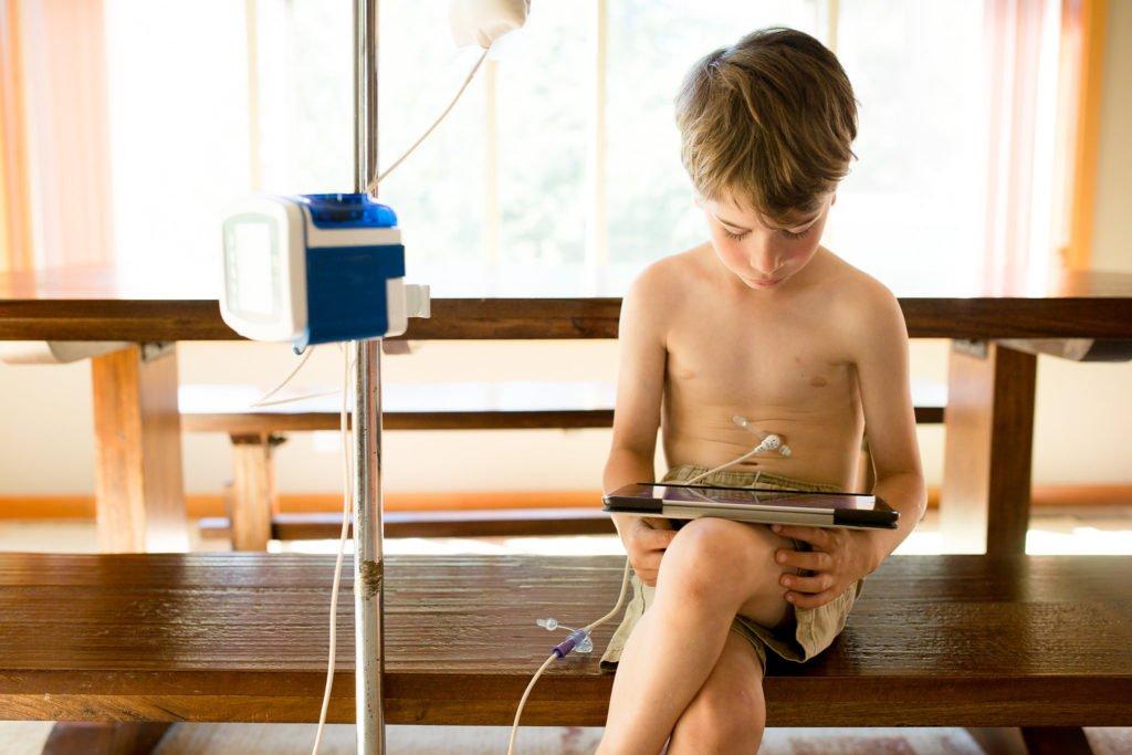 tube-fed-boy-tablet-pad