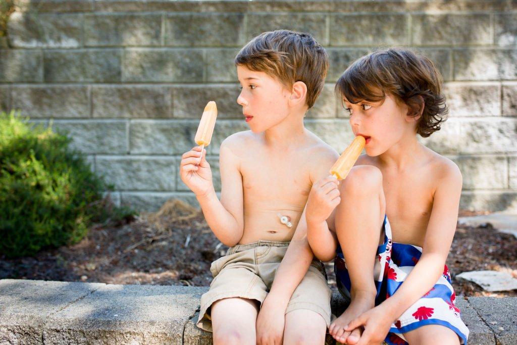 tube-fed-boy-eating-popsicle