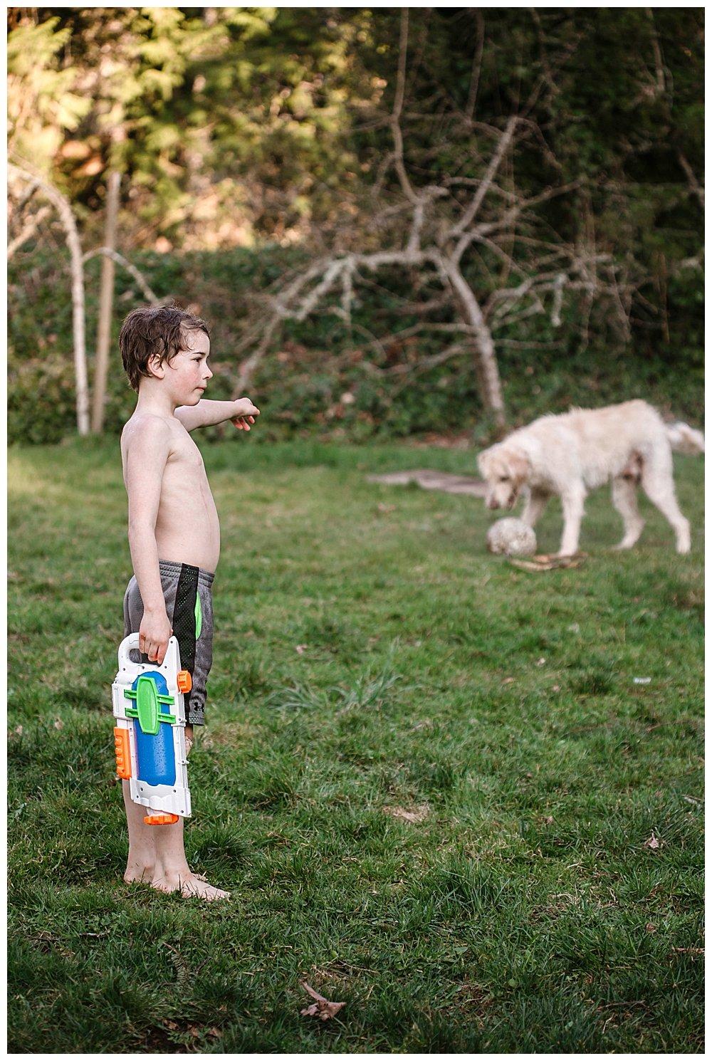 Apollo spraying Frodo with a water gun.