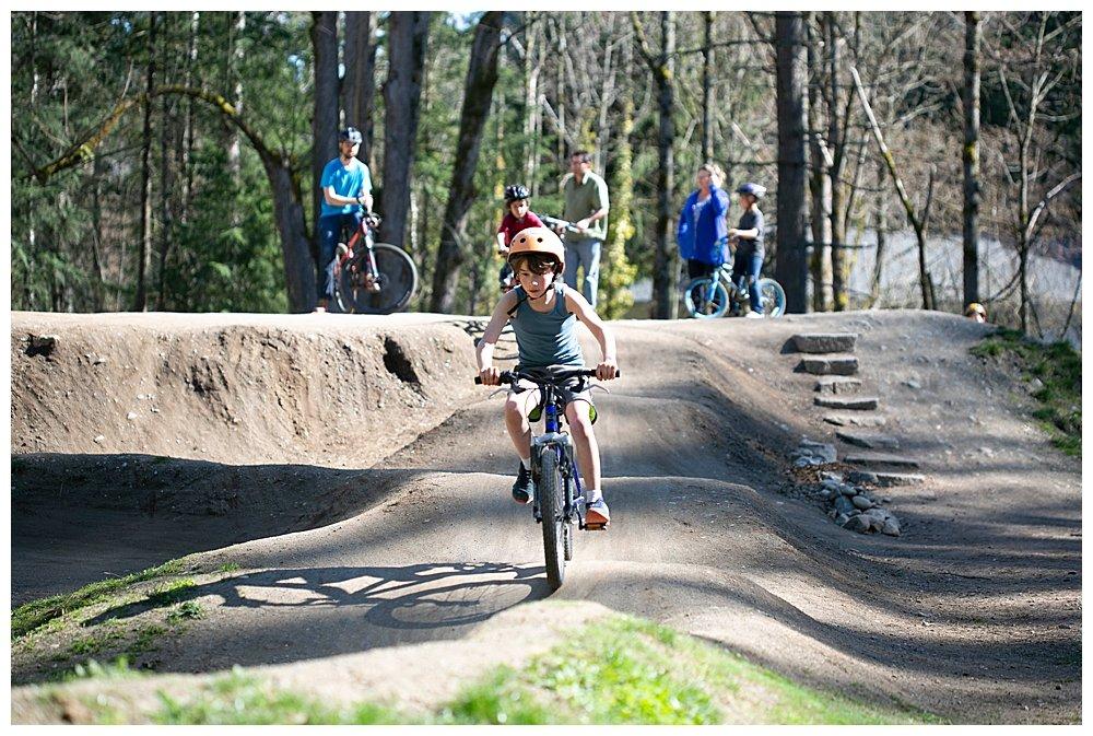 Apollo riding his bike at the Whatcom Falls pump track.