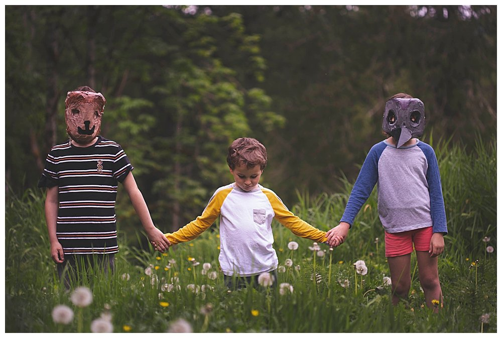 Three kids in animal masks heading to Pet Sematary.